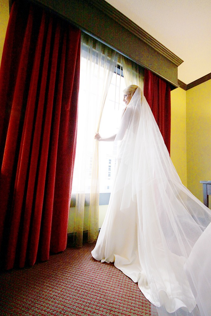 Standing at window Wedding Day