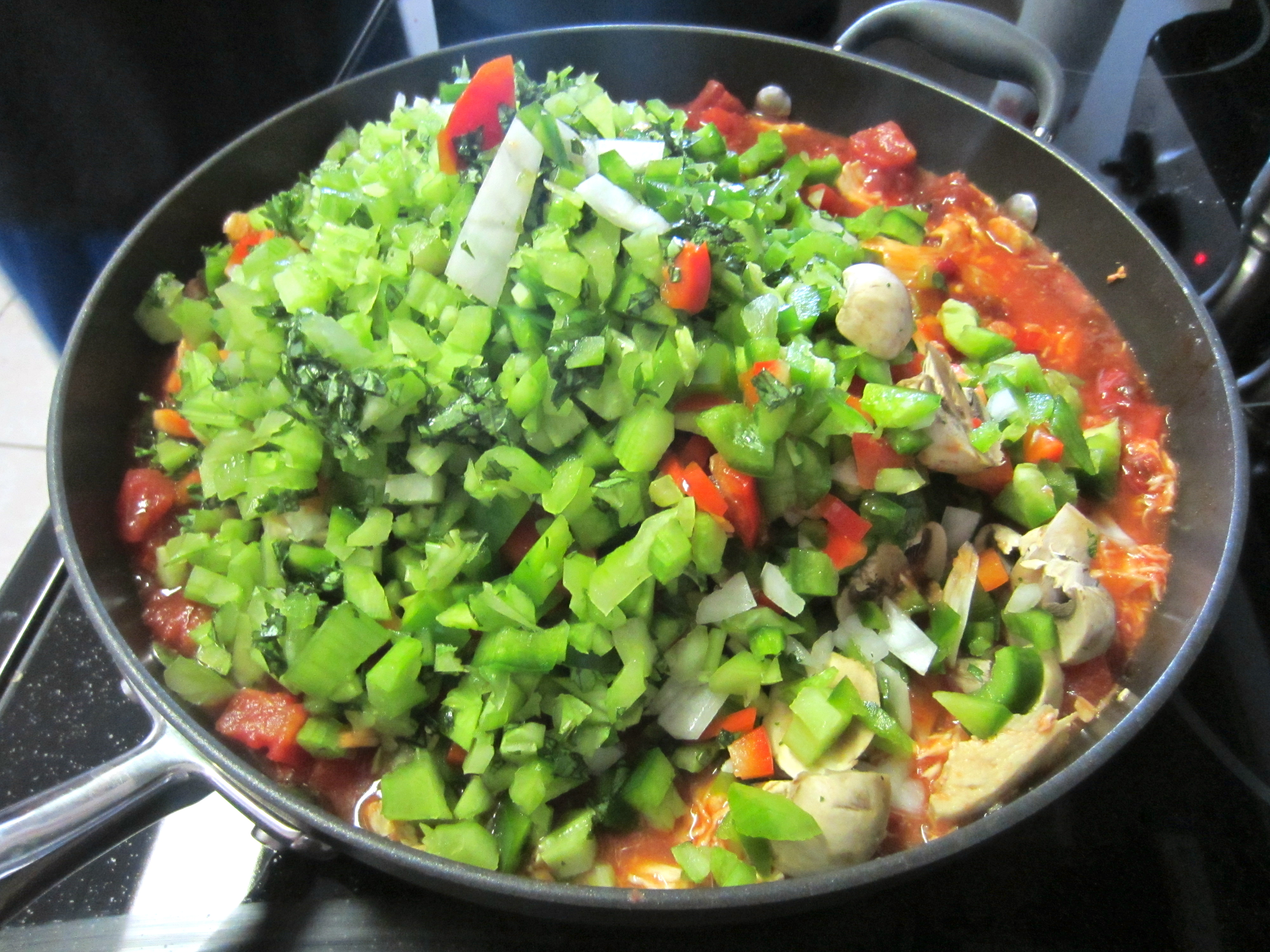 Add chopped veggies to meat and sauce