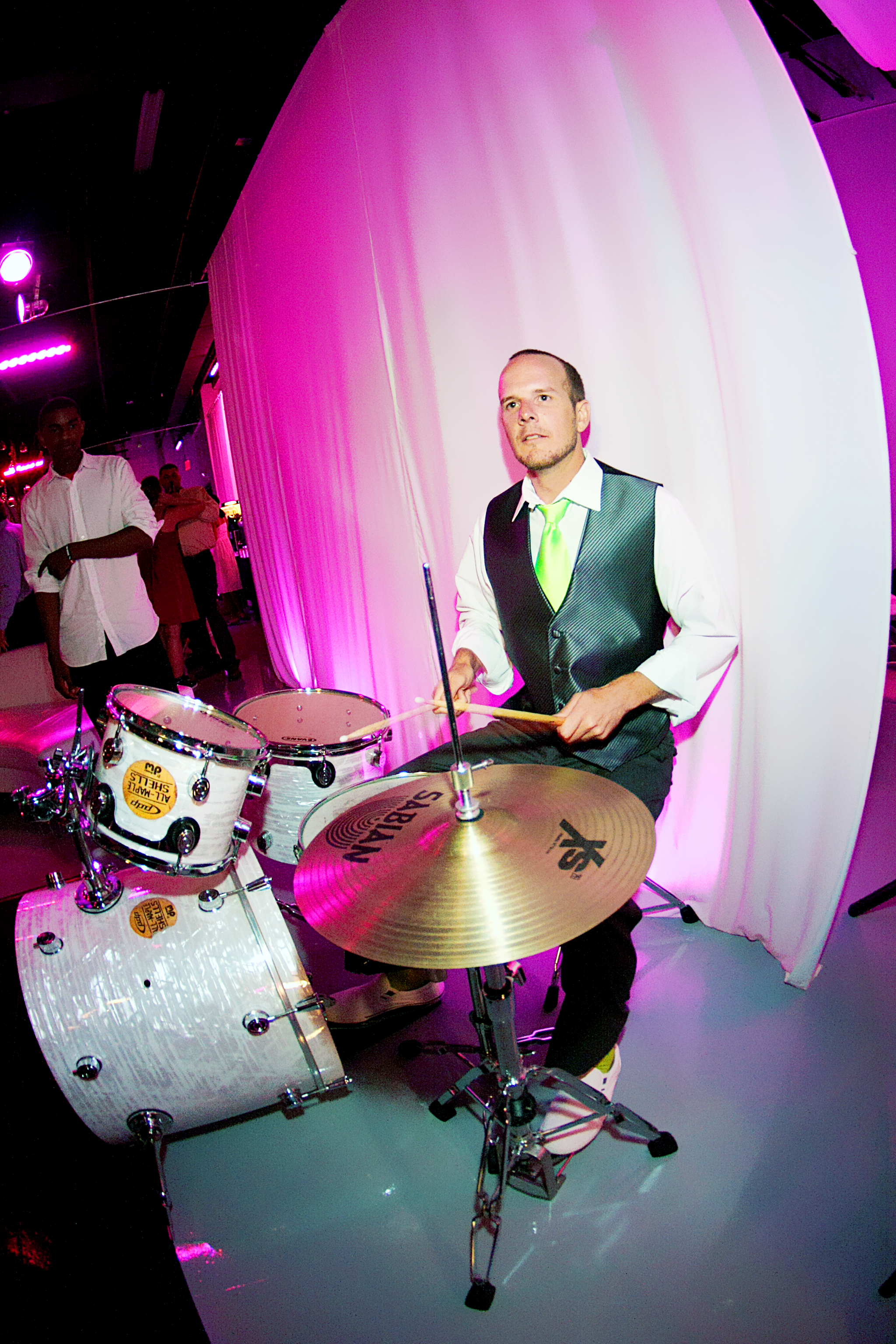 Groomsmen plays the drums