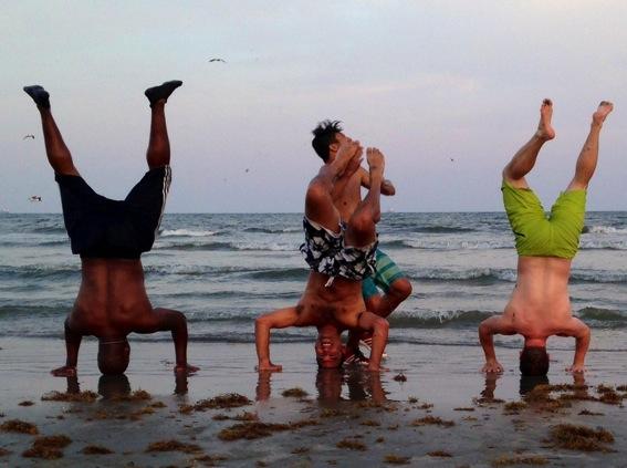 Boys being crazy on the beach jpg