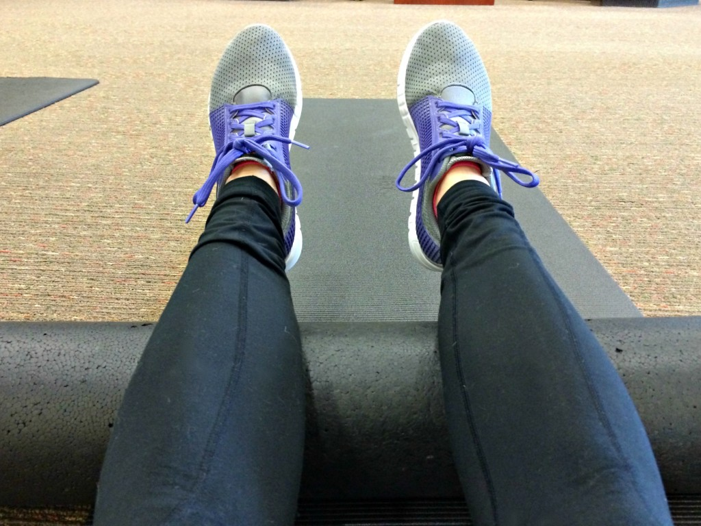 using the foam roller at the gym