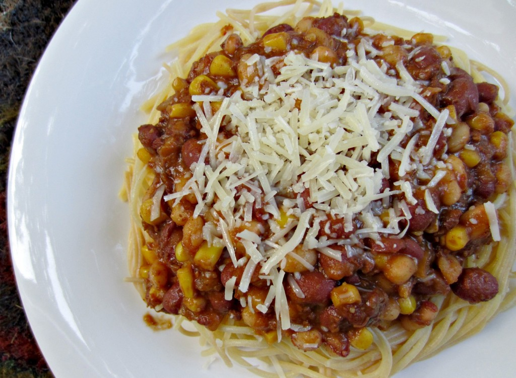 chili over noodles with beans and parmesan