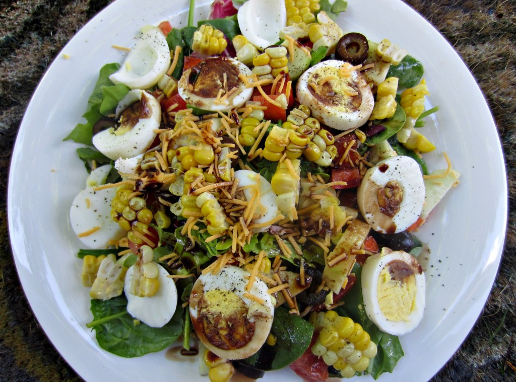 healthy salad with eggs vegetables and corn