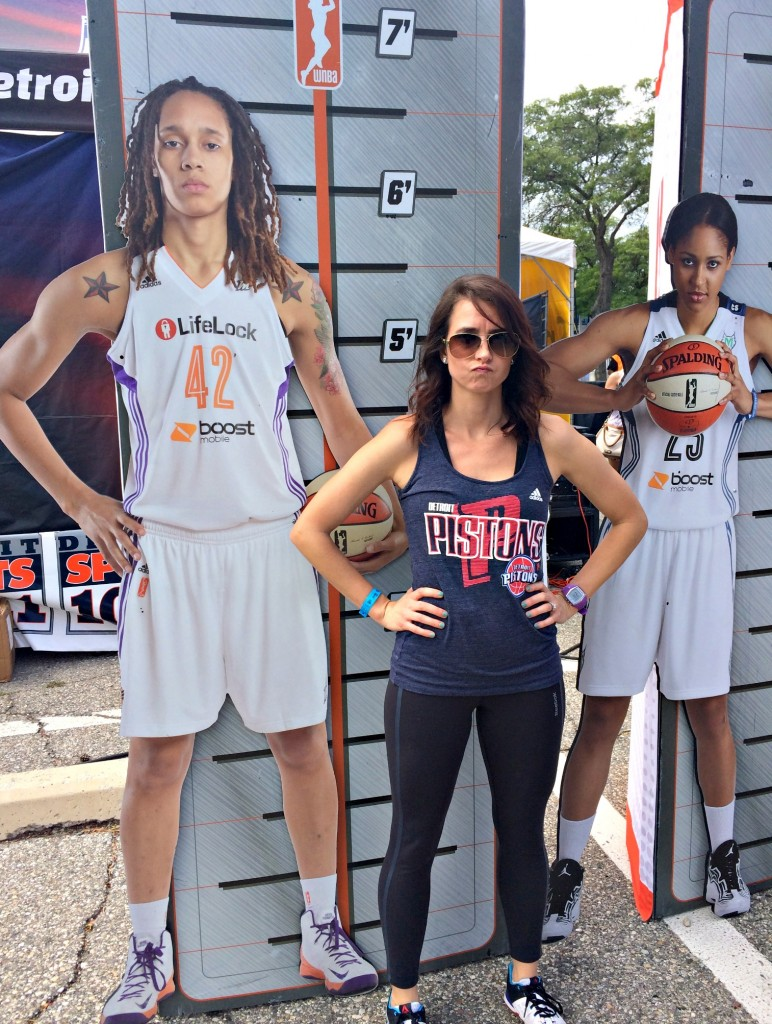 standing with WNBA cutouts