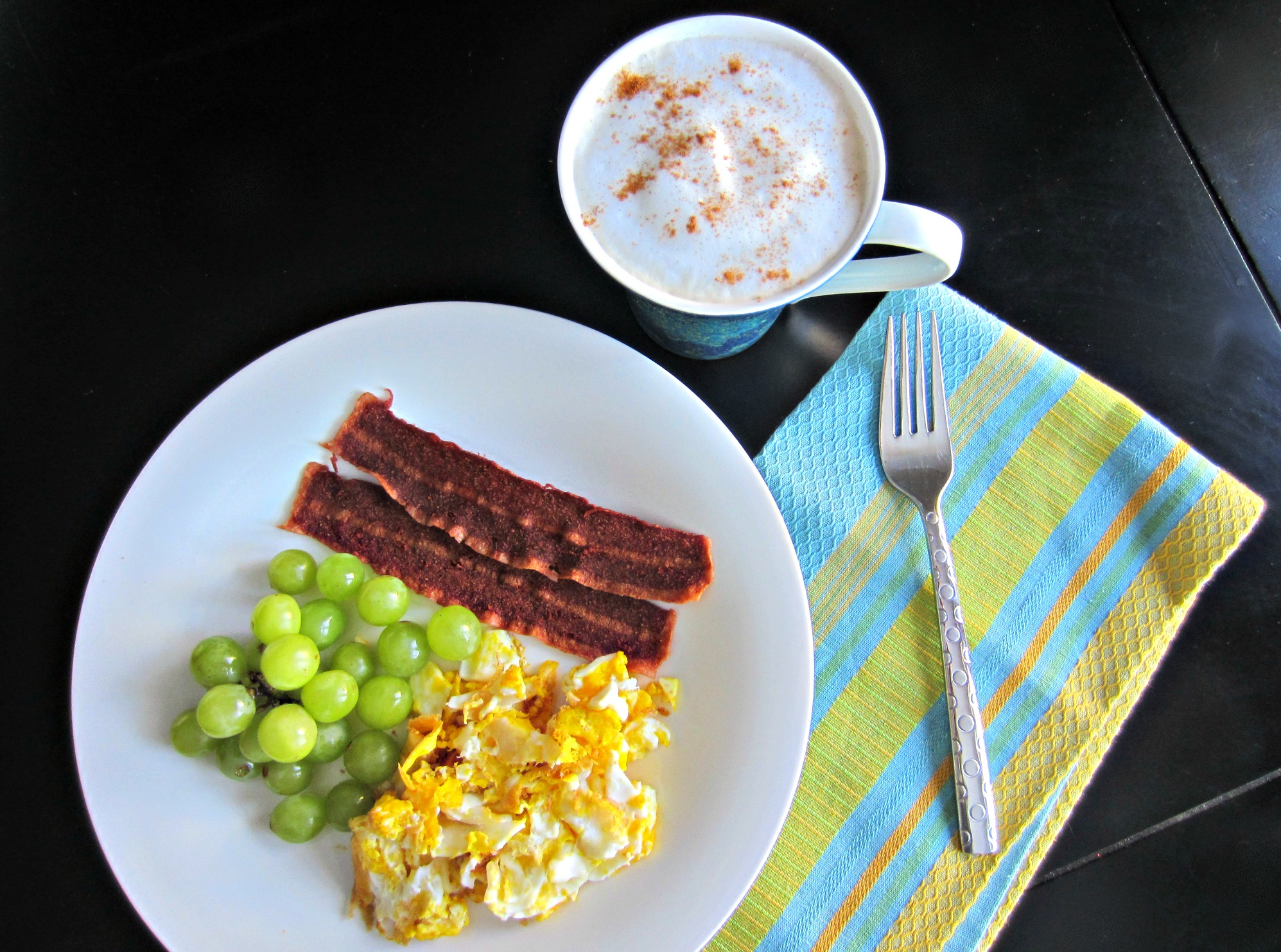 eggs and turkey bacon breakfast with fruit and coffee